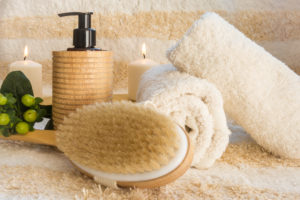 Cozy SPA setting ready for massage with the natural brush and oil
