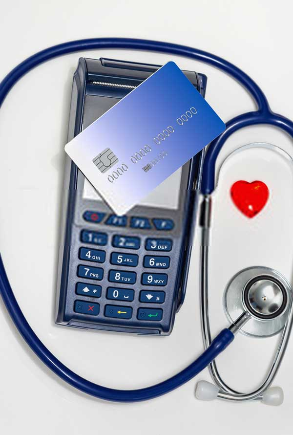 payment for thermography services with phone calculator and stethascope and credit card concept image