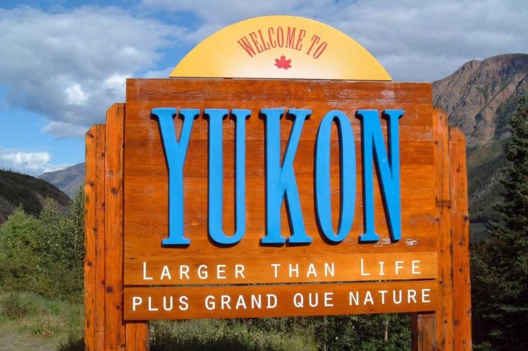 welcome sign to yukon oklahoma outside health food store